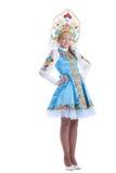 查出的蓝色俄国服装的秀丽女孩 免版税库存照片