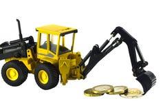 查出的货币拖拉机 库存图片