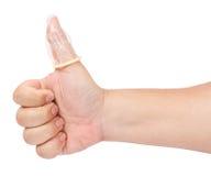 查出的避孕套手指 免版税图库摄影