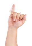 查出的避孕套手指 免版税库存图片