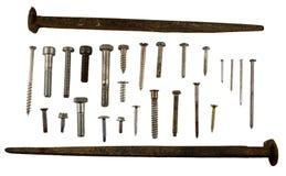 查出的钉子、螺丝和峰值 免版税图库摄影