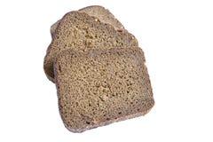 查出的黑面包切白色 免版税图库摄影