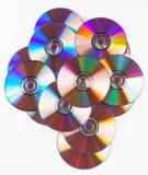 查出的cds五颜六色的dvds 免版税库存照片
