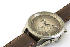 查出 关闭 人` s手表在白色背景 顺时针 免版税库存图片