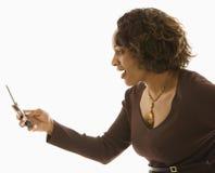 查找妇女的移动电话 免版税库存图片