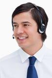 查找对端的微笑的男性呼叫中心座席 图库摄影