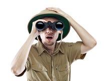 查找通过双筒望远镜的惊奇探险家 免版税库存图片
