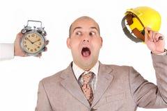 查看时钟预警的生意人 库存照片
