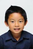 查看照相机的亚裔男孩 库存图片