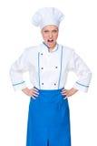 查看照相机的恼怒的女性厨师 库存照片