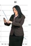 查看电话的女商人 免版税库存图片