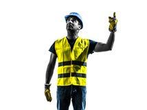 查寻卷扬机剪影的建筑工人信号 免版税库存图片