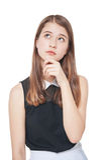 年轻查寻在某事的玻璃的时尚十几岁的女孩是 免版税库存图片