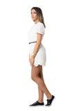查寻白色鞋带的礼服的沉思少妇 侧视图 库存照片