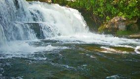 柬埔寨-与瀑布的风景在一条小河 免版税库存图片