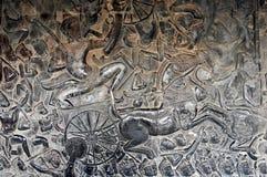 柬埔寨-从吴哥窟寺庙的浅浮雕 免版税库存照片