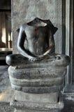 柬埔寨-在从吴哥窟寺庙的莲花坐供以座位的雕象 库存照片