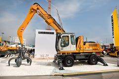 柴油挖掘机黄色 免版税库存照片