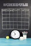 栅格在黑黑板背景的时间表日程表 免版税库存图片
