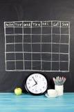 栅格在黑黑板背景的时间表日程表 免版税图库摄影