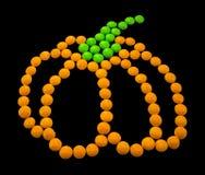 标志万圣夜-南瓜 组成由小圆的糖果 免版税图库摄影