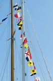 标志帆柱游艇 库存图片