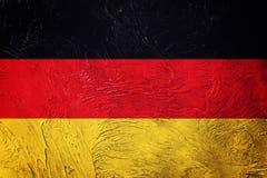 标志德国grunge 与难看的东西纹理的德国旗子 库存照片