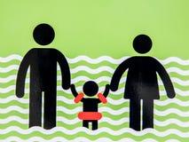 标志成人继续看到他们的孩子 免版税图库摄影
