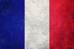 标志法国grunge 与难看的东西纹理的法国旗子 图库摄影