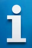 标志由纸制成有蓝色背景 免版税库存照片