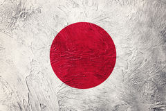 标志grunge日本 与难看的东西纹理的日本旗子 免版税图库摄影