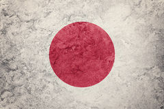 标志grunge日本 与难看的东西纹理的日本旗子 免版税库存照片