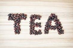 标题茶composited干野玫瑰果 图库摄影