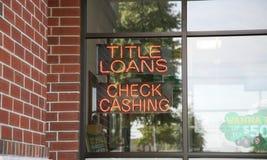 标题贷款和检查兑现 免版税库存图片