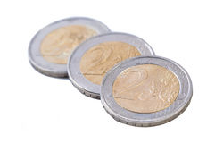 栈在空白背景的硬币 免版税库存图片