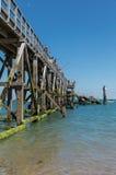 栈桥的渔夫 库存图片