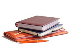 栈笔记本、日志和计划 免版税库存图片