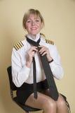 栓一致的领带的女性上尉 免版税库存图片