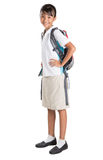 校服和背包的VI女孩 库存照片