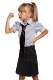 校服的小女孩 免版税图库摄影