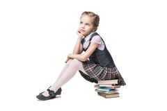 校服的美丽的小女孩有书的 库存图片