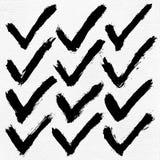 校验标志在水彩纸的墨水剪影 图库摄影