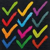 校验标志在水彩纸的墨水剪影 库存图片
