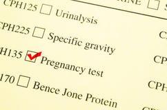 校验标志医疗形式请求妊娠试验 免版税库存图片