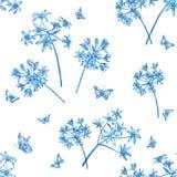 样式开花蓝色和蝴蝶 免版税库存照片