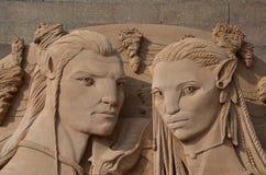 根据具体化电影的沙子雕塑 免版税库存照片