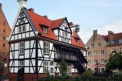 格但斯克,波兰- 2014年6月07日:叫作磨房协会的议院的半木料半灰泥的大厦  库存图片