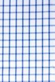 格子花呢披肩桌衣裳-蓝色织品棉花 免版税图库摄影