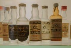 格拉巴酒瓶 免版税库存图片
