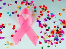桃红色丝带乳腺癌,乳腺癌了悟、胃肠癌症了悟和10月桃红色天背景 图库摄影